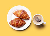 istock croissant and coffee. 1273262730