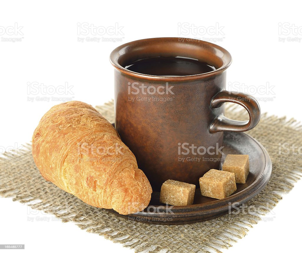 Croissant and cup of coffee royalty-free stock photo