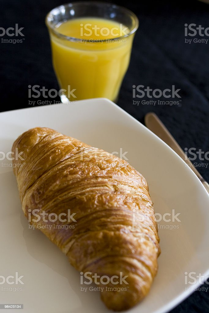Croissant and OJ royalty-free stock photo