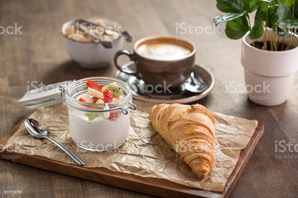 Croissant and yogurt with berries stock photo