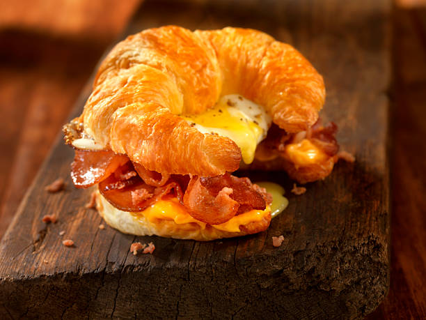 Croissant Breakfast Sandwich with Bacon,egg and Cheese Croissant Breakfast Sandwich with Bacon,egg and Cheese - Photographed on Hasselblad H3D2-39mb Camera croissant stock pictures, royalty-free photos & images