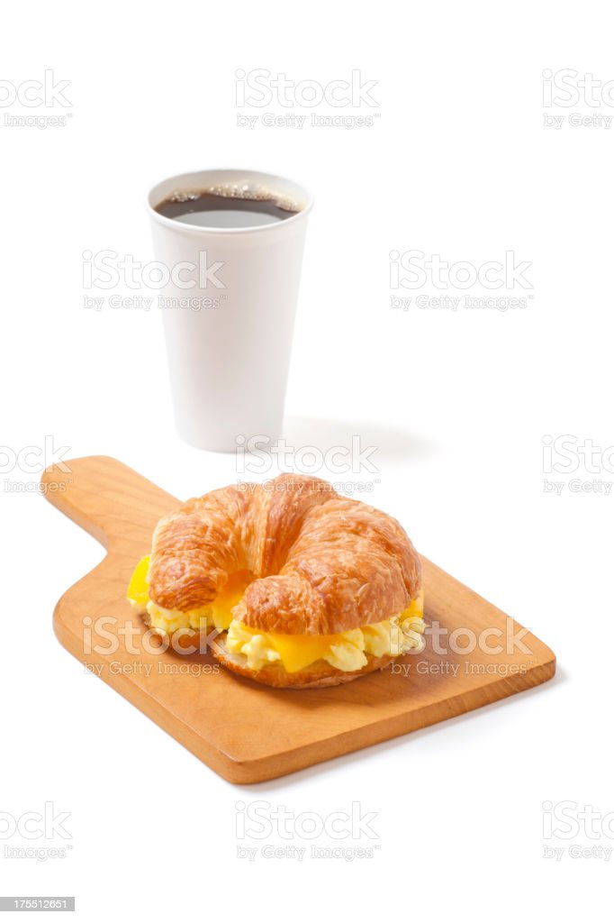 Croissant Breakfast Sandwich with Egg, Cheese, and Coffee bildbanksfoto