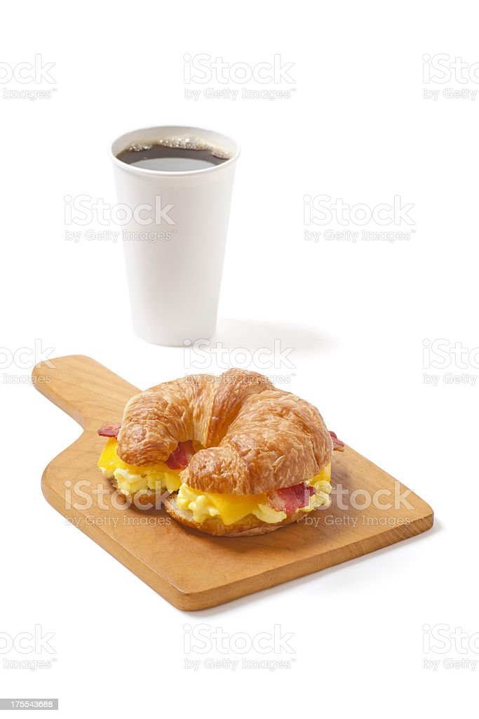 Croissant Breakfast Sandwich with Egg, Cheese, Bacon and Coffee bildbanksfoto