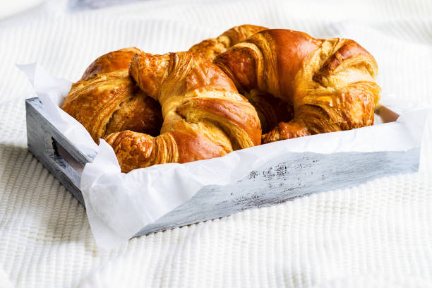 Croissant for breakfast on white woolen surface - foto stock