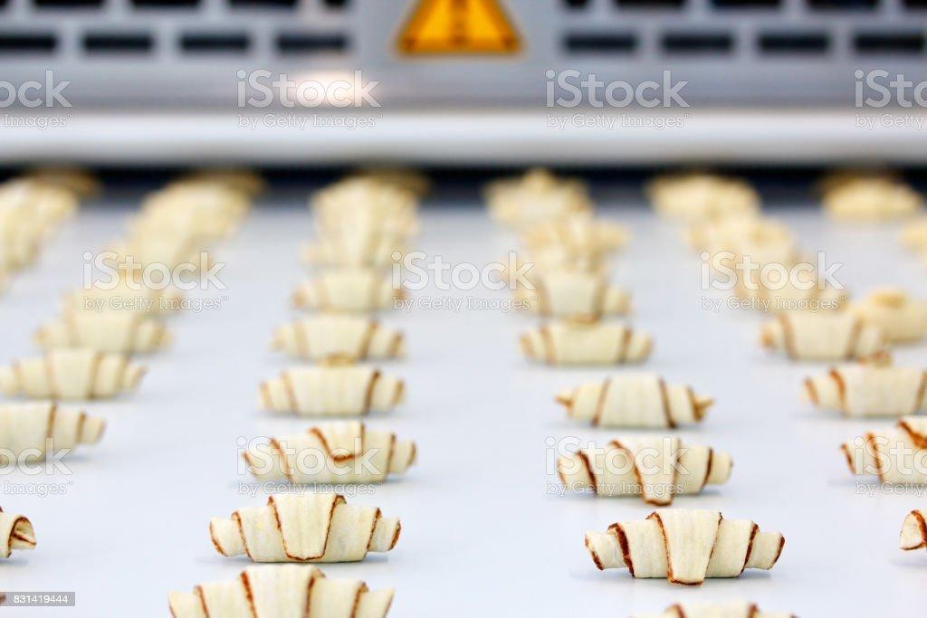 croissant production process stock photo