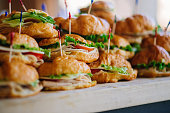 Stack of croissant sandwich at wedding reception party