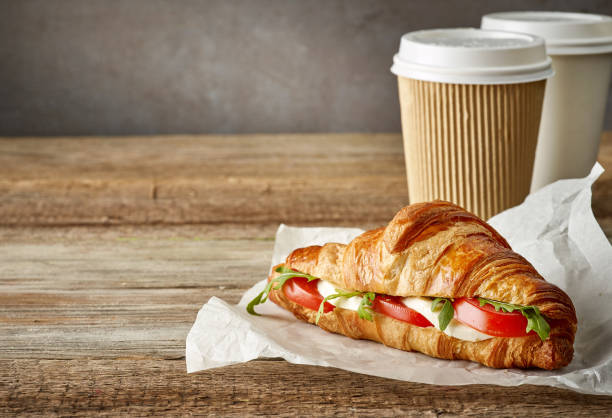croissant sandwich with tomato and mozzarella stock photo