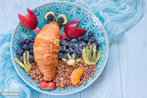 istock Croissant with berries for funny kids breakfast 695498400