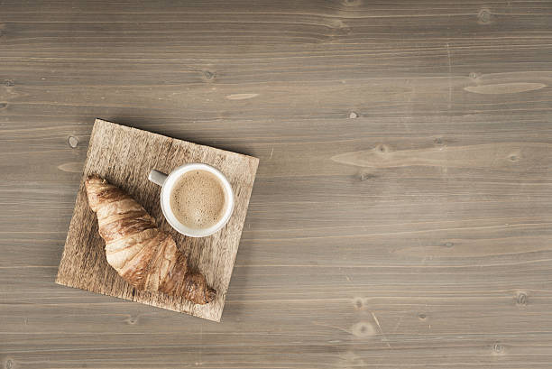 Croissant with coffee on top view stock photo