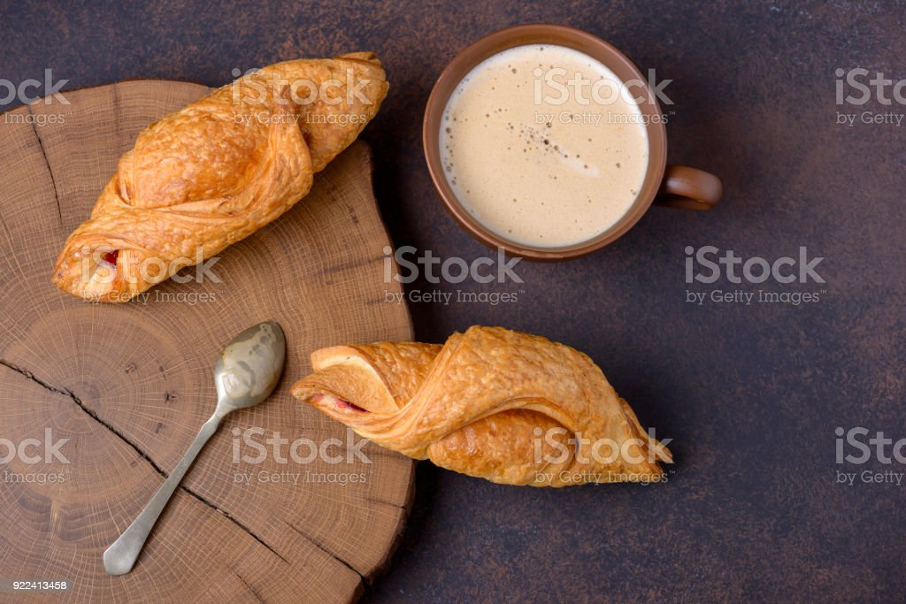 Croissants and coffee on table, top view stock photo