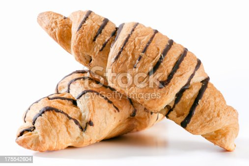 Two croissants on white background. Selective focus, shallow DOF.