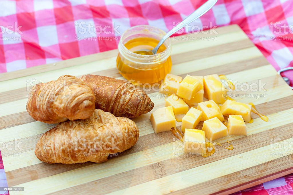 Croissants with cheese and honey stock photo