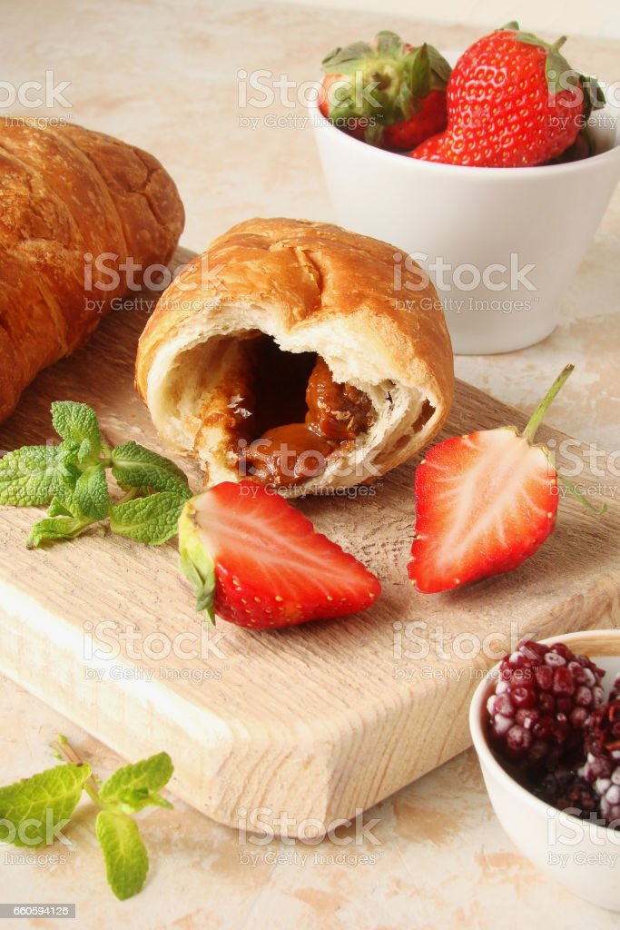 croissants with chocolate cream and berry strawberry royalty-free stock photo