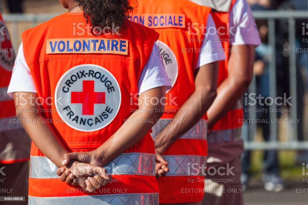 "Croix Rouge Française Saint Denis, Reunion Island - July 14 2016: Members of the ""Croix Rouge Française"" parading during Bastille Day. Bastille Day Stock Photo"