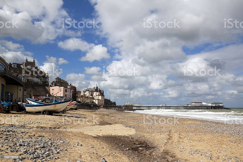 Cromer beach with boats and pier stock photo