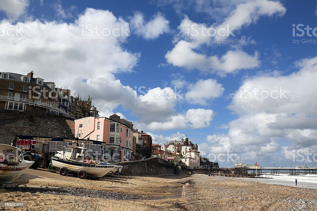 Cromer beach with boats and town stock photo