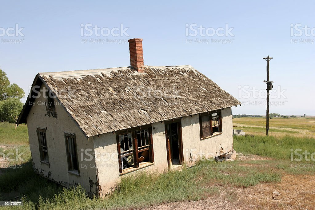 crooked and abandoned home royalty-free stock photo