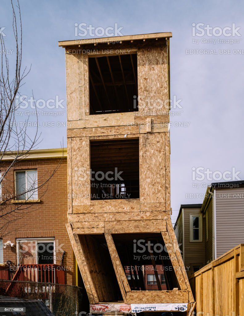 Crooked house in construction stock photo