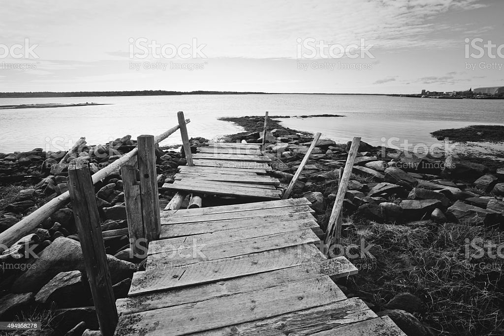 Crooked old wooden dock stock photo