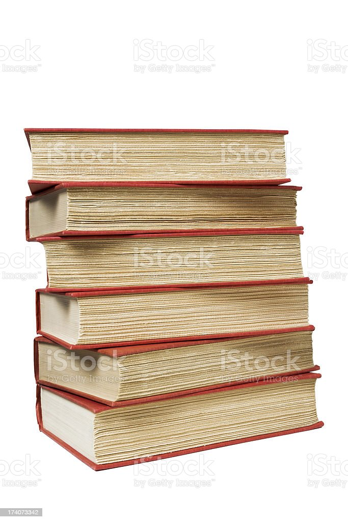 Crooked stack of old hardcover books with roughly trimmed pages royalty-free stock photo