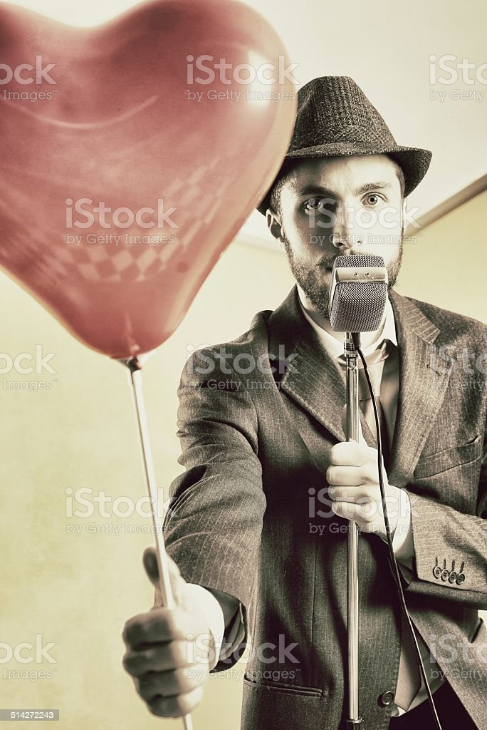 Crooner with Balloon in the Shape of Heart. 50's style stock photo