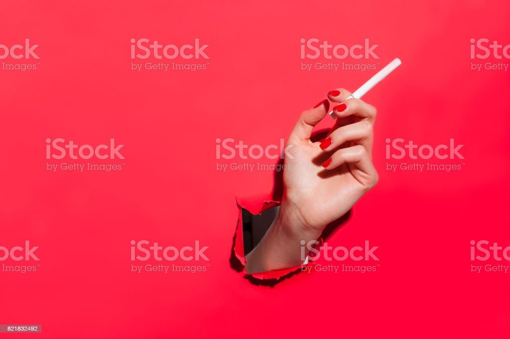 Crop female hand with cigarette stock photo