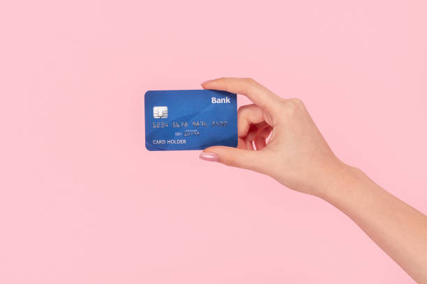 Crop girl with blue credit card stock photo