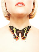 istock Crop of woman with a black butterfly on her neck 184370675