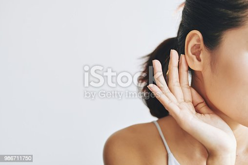 istock Crop woman touching face 986711750