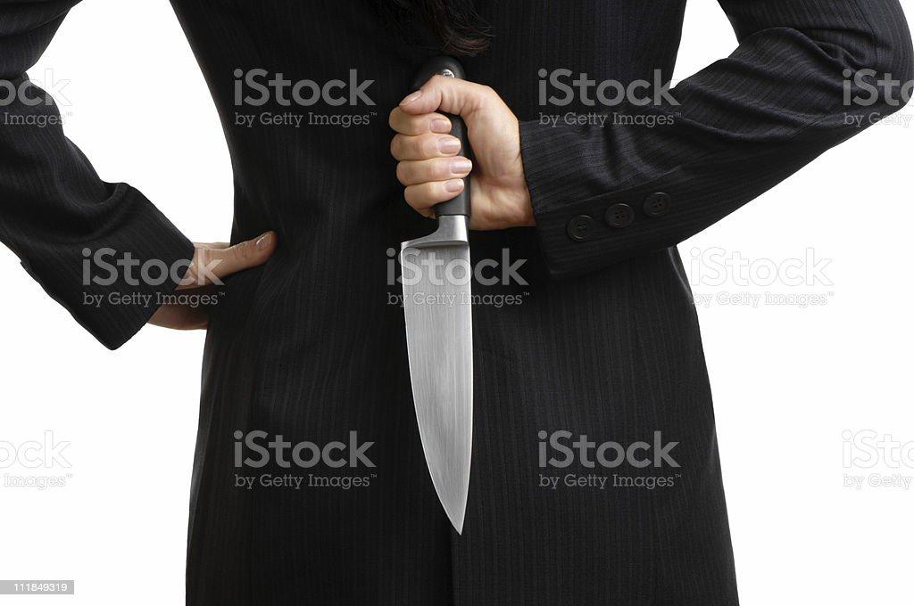 Cropped Businesswoman Holding Knife Behind Back Isolated on White Background royalty-free stock photo