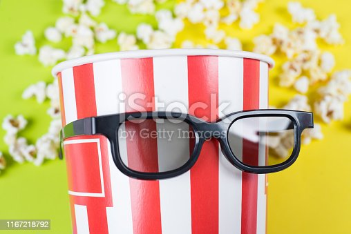 956942702 istock photo Cropped close up photo of behaving like a human confident nice trend bag with popcorn wearing black 3d specs isolated over vivid background 1167218792
