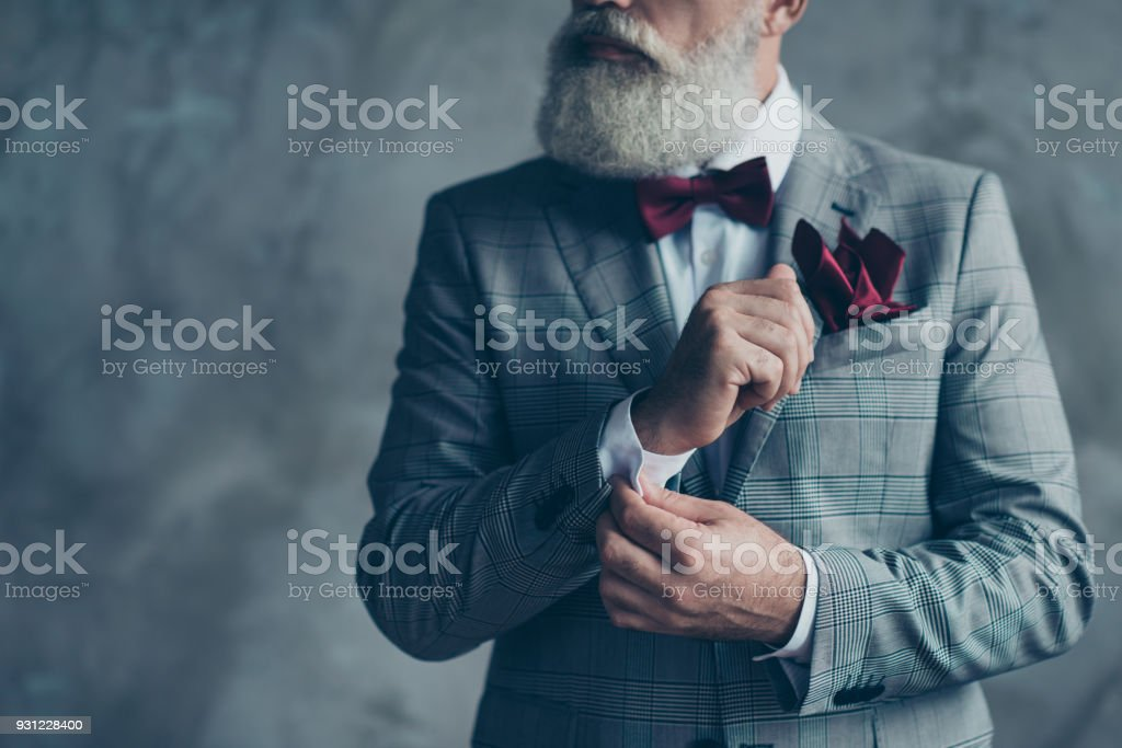 Cropped close up photo of chic virile luxurious trendy wealthy rich sharp well-dressed with burgundy accessories checkered jacket intelligent hipster grandpa fixing cuffs isolated on grey background stock photo