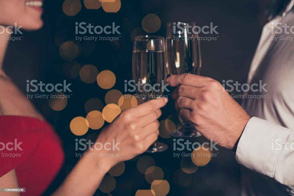 Cropped close up photo of holding hand of couple people with beverage in hands celebrate the best sweet night party stock photo