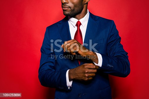 istock Cropped close up photo of sale manager entrepreneur chic employee employer occupation leadership gentleman groomed man correct cufflink fasten clasp on wrist isolated on red bright background 1054253694