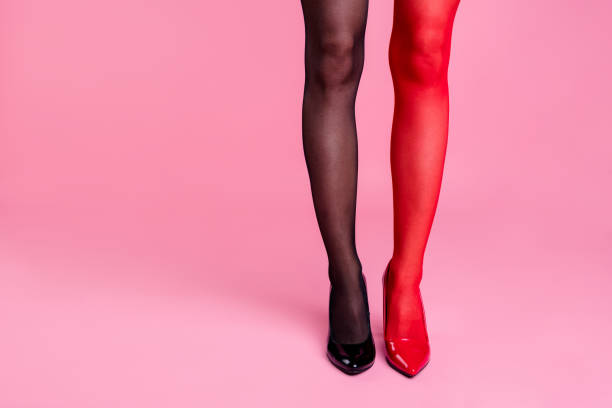 cropped close up photo skinny perfect ideal different colored stockings she her lady legs try all variants not sure what is right for office work job style isolated pink rose background - black women wearing pantyhose stock photos and pictures