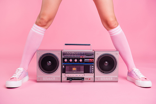 Cropped close up photo skinny perfect ideal she her lady legs opposite standing boom box play between teens hanging out celebrating weekend holiday isolated pink rose background
