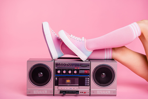 Cropped close up photo skinny perfect ideal she her lady legs lying near boom box play on fitness training workout press swing happy glad be in fit soundtrack turned on isolated pink rose background