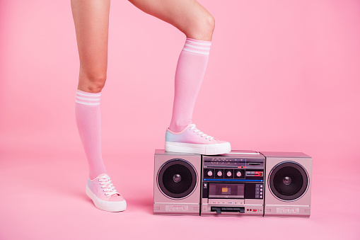 Cropped close up photo skinny perfect ideal she her lady legs standing on boom box play on fitness training happy glad be in fit soundtrack turned on isolated pink rose background