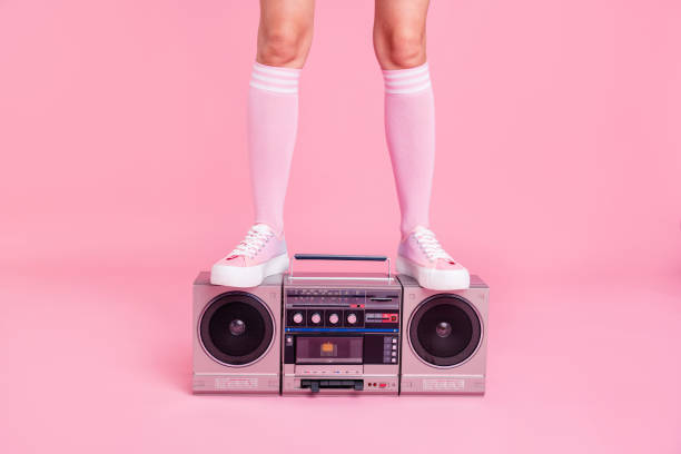 Cropped close up photo skinny perfect ideal she her lady legs standing on boom box play fitness coach happy glad see new members of fit life team soundtrack turned on isolated pink rose background stock photo