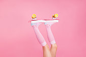 Cropped close up photo skinny perfect ideal she her lady legs raised up holding skateboard rolling in air enthusiast isolated pink rose background