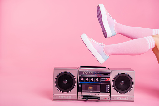 Cropped close up photo skinny perfect ideal she her lady legs raised up lying near boom box playing fitness training workout press swing happy soundtrack turned on isolated pink rose background