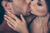 Cropped close up profile side view photo of sensitive alluring tempting passionate hot desirable dreamy kiss between horny sexy beautiful attractive charming handsome lovers touching with hands