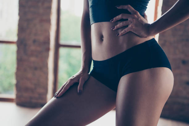 Cropped close-up belly graceful beautiful strong model sporty sl stock photo