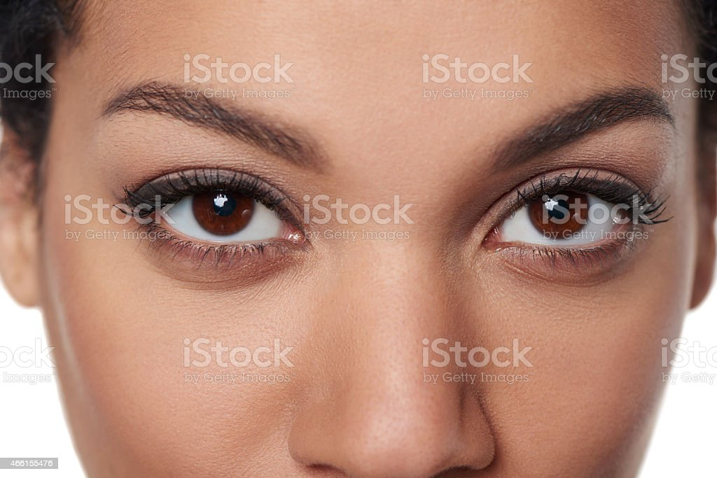 Cropped closeup image of female brown eyes stock photo