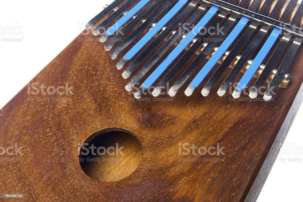 Cropped close-up of used wooden Kalimba (Marimbula) thumb piano royalty-free stock photo