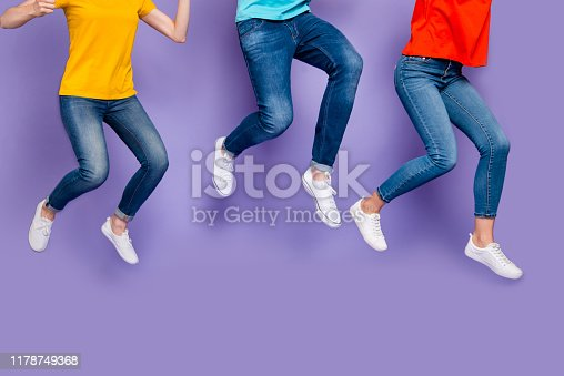 Cropped closeup photo of cheerful crazy ecstatic group of people running marathon, hurrying to get seasonal discounts isolated violet background