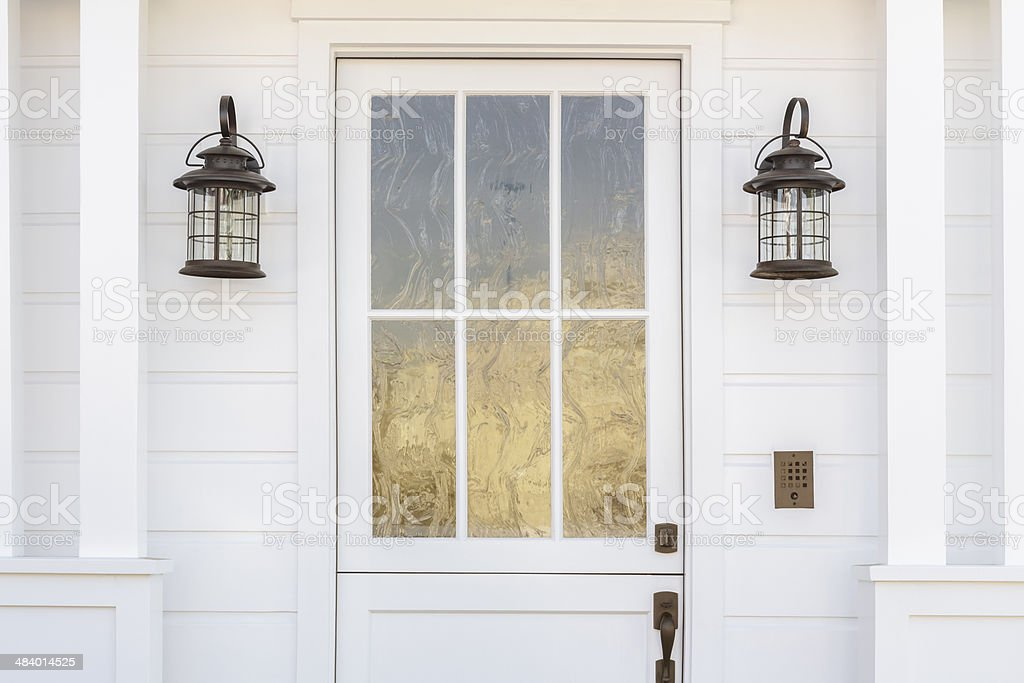 Cropped detail of white door to classic home stock photo