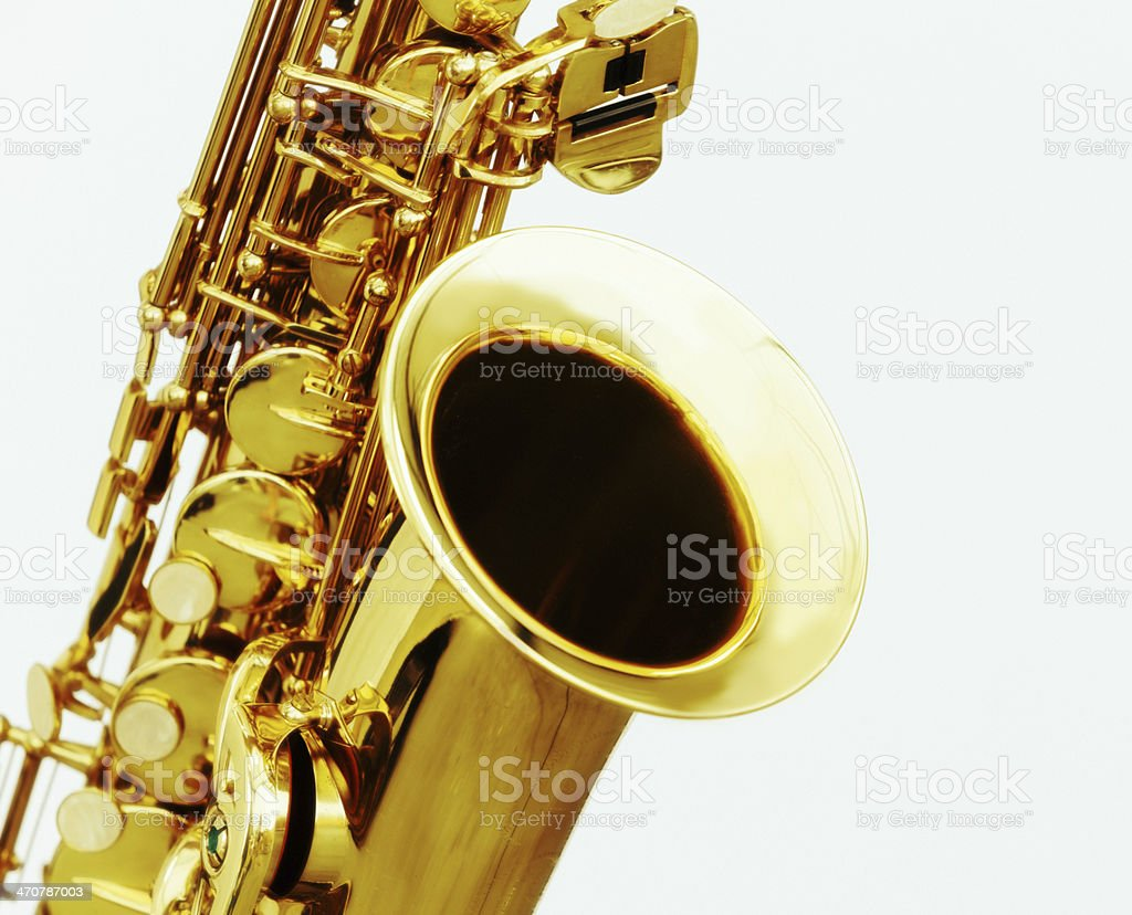 Cropped, high-key close up of alto sax. Isolated on white. stock photo