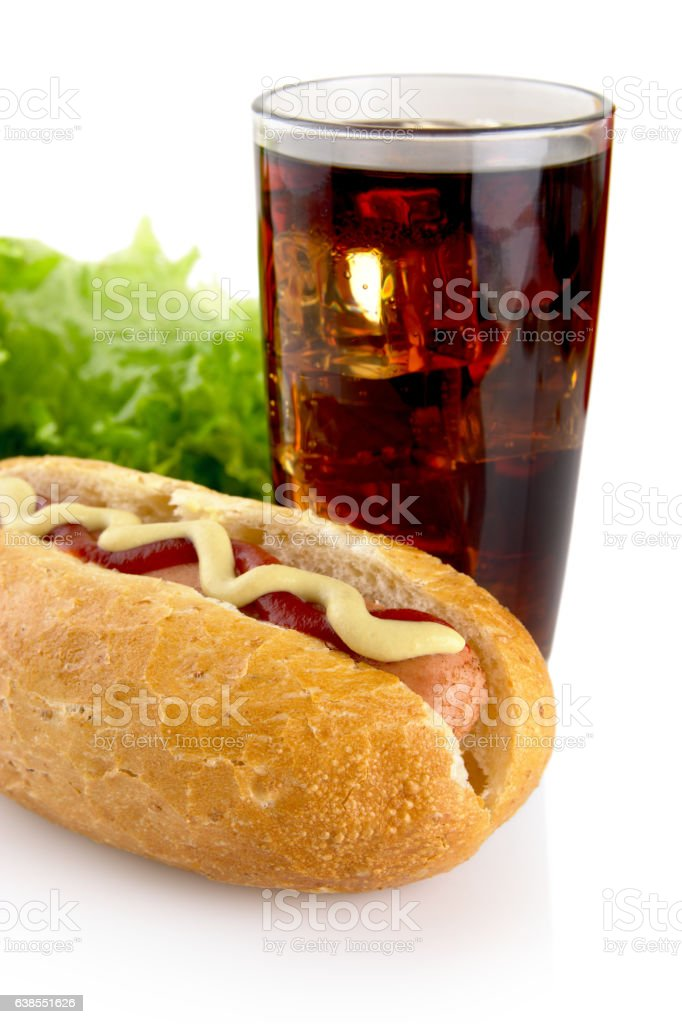 Cropped hotdogs with ketchup with lettuce in the background stock photo