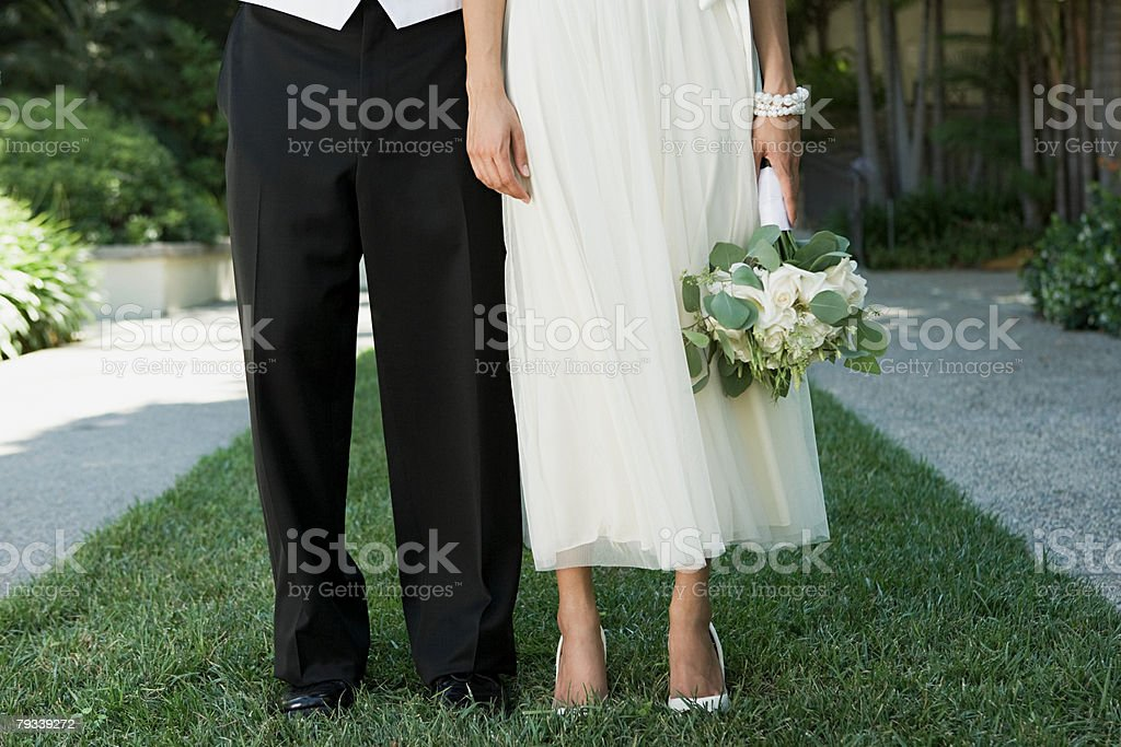 Cropped image of a bride and groom royalty-free stock photo